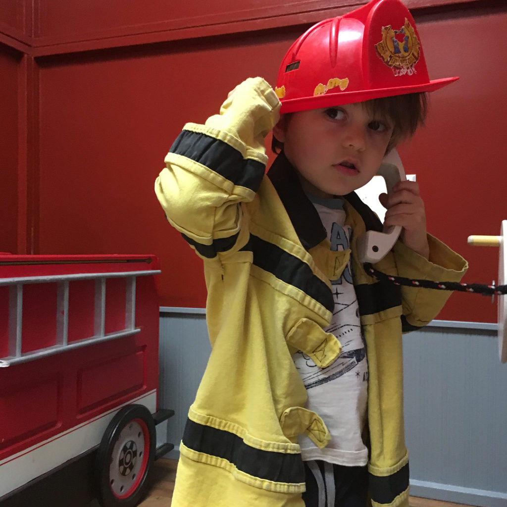 Children's fireman making a phone call